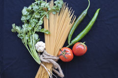 Dried spaghetti cooking ingredients with fresh vegetable Stock Images