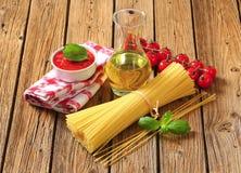 Dried spaghetti, tomato puree and olive oil Stock Photos