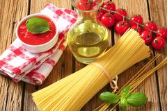 Dried spaghetti, tomato puree and olive oil Royalty Free Stock Image