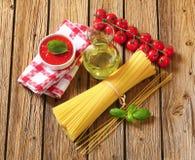 Dried spaghetti, tomato puree and olive oil Stock Image