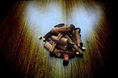 Dried spices. A pile of dried spices on a dark wood background Stock Photos