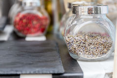 Dried spices and tea in jars Royalty Free Stock Images