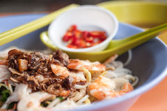 Dried Spicy Prawn Noodle. Hokkien prawn noodle soup is a popular local dish made up of Hokkien mee (thick yellow noodles) in a broth of pork bones and prawn stock photos