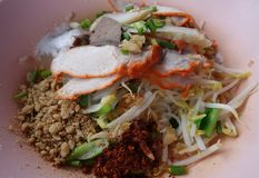 Dried spicy rice noodle with roasted pork Royalty Free Stock Photo