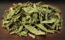 Dried stevia on wooden Royalty Free Stock Photography