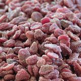 Dried strawberries. Sugared Dried strawberries sold in a market royalty free stock image