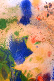 Dried streaks of multicolored paint with cracks Royalty Free Stock Images