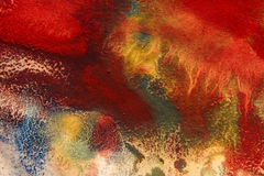 Dried streaks of multicolored paint with cracks Stock Photography
