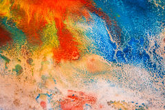 Dried streaks of multicolored paint with cracks Stock Image