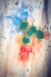 Dried streaks of multicolored paint with cracks Royalty Free Stock Photo