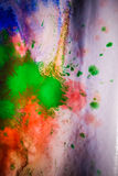 Dried streaks of multicolored paint with cracks Stock Photos