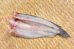 Dried striped snakehead fish. Thai traditional dried striped snakehead fish on bamboo threshing basket Stock Images