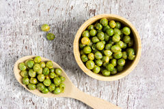 Dried Sugar Peas in wood bowl.top view Stock Images