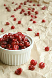 Dried sweet cherries in white ramekin Royalty Free Stock Photo