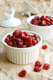 Dried sweet cherries in white ramekin Royalty Free Stock Photography