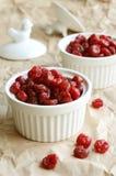 Dried sweet cherries in white ramekin Royalty Free Stock Photography