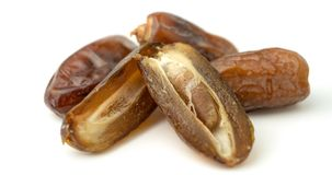 Dried of sweet dates palm fruits on white background. Dates is a dried fruit that provides high energy.  royalty free stock photos