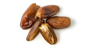 Dried of sweet dates palm fruits on white background. Dates is a dried fruit that provides high energy.  stock image