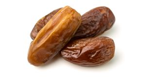 Dried of sweet dates palm fruits on white background. Dates is a dried fruit that provides high energy. Dried of sweet dates palm fruits on white background stock photos