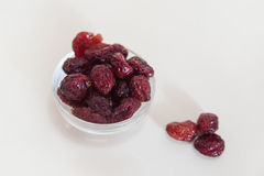 Dried sweetened cranberries in a glass bowl. Tasty vegetarian snack in a transparent glass bowl, healthy choice for consumers, or as part of five a day fruit and royalty free stock photography