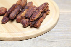 Dried tamarind on a  cutting board Royalty Free Stock Photography