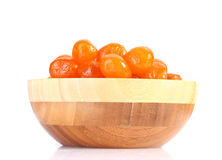 Dried tangerines in wooden bowl Stock Photos