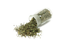 Dried tarragon leaves in a glass bottle Royalty Free Stock Photo