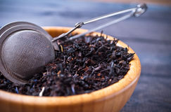 Dried tea leaves in bowl Royalty Free Stock Images