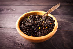 Dried tea leaves in bowl Stock Photo