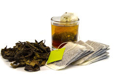 Dried tea with teabag  and cup Stock Images