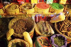 Dried teas and spices in baskets on the traditional market royalty free stock photography