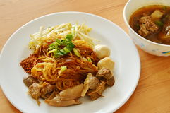 Dried thin rice noodle topping braised pork and brown bone soup Stock Photo