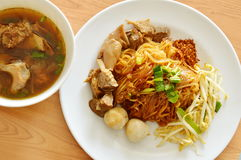 Dried thin rice noodle topping braised pork and brown bone soup Royalty Free Stock Photography