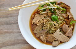 Dried thin rice noodle topping braised pork and liver in brown soup Stock Image