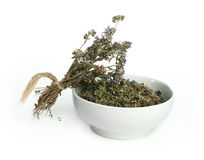 Dried thyme in a bowl and thyme twigs Royalty Free Stock Photo