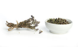 Dried thyme in a bowl and thyme twigs Royalty Free Stock Photos