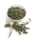 Dried thyme in a bowl and thyme twigs Royalty Free Stock Image