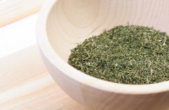 Dried thyme in wooden bowl Stock Images