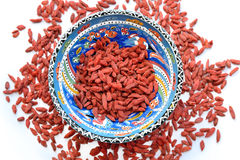 Dried Tibetan goji berries in ceramic bowl isolated on white background Royalty Free Stock Images