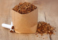 Dried tobacco leaves with cigarette Stock Photography