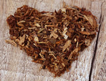 Dried tobacco leaves  decorated in heart shape Royalty Free Stock Photos