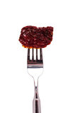 Dried tomato on a fork Royalty Free Stock Photos