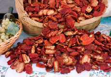 Dried tomatoes. Basket of italian tomatoes dried at the sun Royalty Free Stock Photography