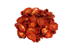 Dried tomatoes. Cut slices on white background Stock Images
