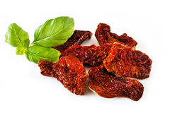 Dried tomatoes and basil Royalty Free Stock Photo