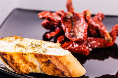 Dried tomatoes with bread Royalty Free Stock Image