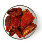 Dried tomatoes in a glass bowl Stock Image