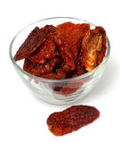 Dried tomatoes in a glass bowl Stock Photography