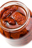 Dried tomatoes in glass jar Royalty Free Stock Images