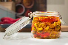 Dried tomatoes in glass jar. Homemade dried tomatoes in glass jar Royalty Free Stock Photo